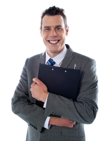 Happy businessman holding a clipboard isolated over white background photo