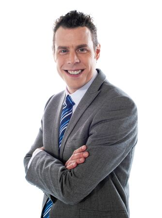 Close-up shot of handsome executive posing with folded arms Stock Photo - 13217594