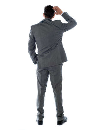 Back-pose of a corporate person thinking. Isolated over white background photo