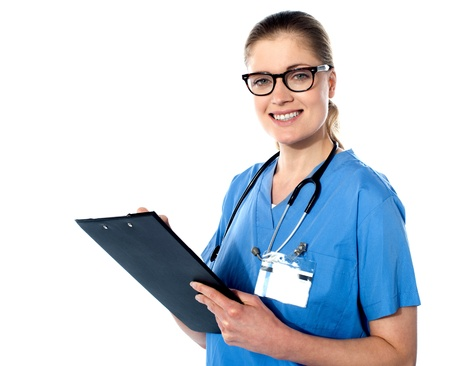 Friendly female doctor with a clipboard isolated over white