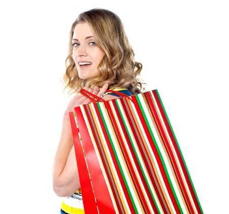 Close-up of happy shopping girl holding bags Stock Photo - 13217638