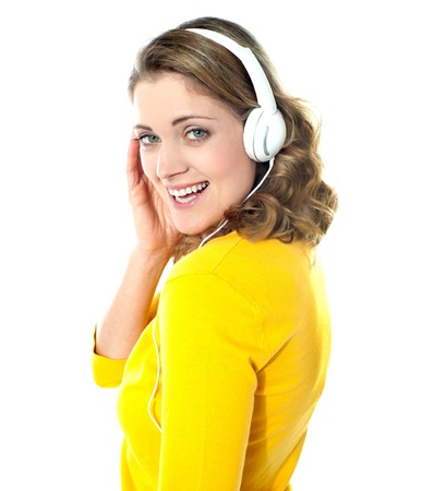 tuned: Attractive teenager tuned into music on her mp3 player