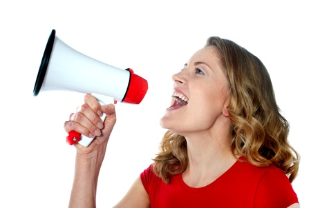 Female spokesperson holding megaphone isolated over white photo