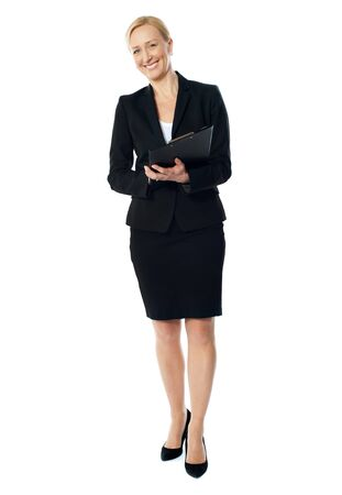 female executive: Aged female executive holding business file isolated over white