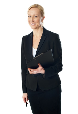 Beautiful caucasian businesswoman holding clipboard and pen, smiling Stock Photo - 13217789