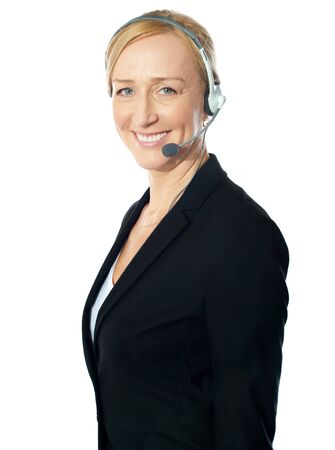 customercare: Aged female call centre excutive posing with headsets, smiling