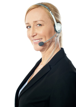 customercare: Closeup of a senior telemarker woman with headsets isolated over white background