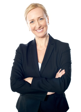 Smiling gorgeous businesslady posing with crossed arms