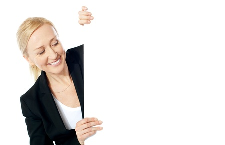 Pretty attractive businesswoman holding blank advertising board Stock Photo - 13217755