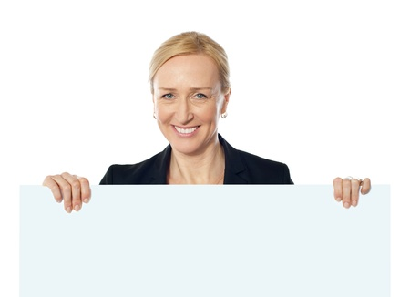 Senior lady represting ad space. Holding white blank billboard Stock Photo - 13217712