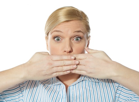 Surprised Young female posing with hands on her mouth Stock Photo - 13217917
