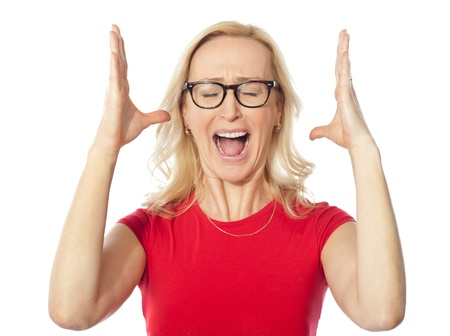 Frustrated aged woman shouting  Isolated over white