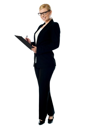 documenting: Businesswoman with a clipboard, side view Stock Photo