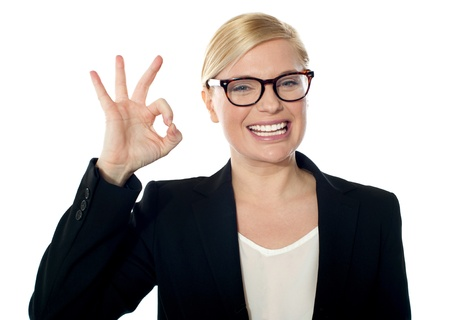 Successful business woman posing with ok sign, isolated over white photo
