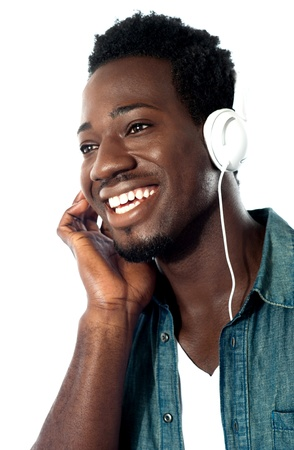 Young man with headphones enjoying music photo