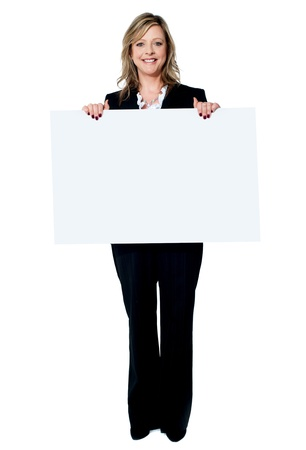 Senior beautiful woman smiling showing blank white placard isolated on white background photo