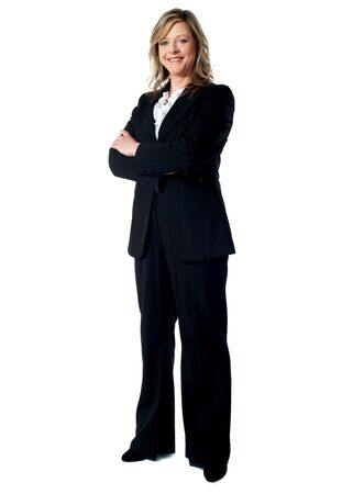 woman standing: Full length portrait of an experienced business woman standing with arms folded