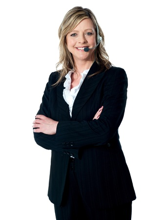 Portrait of happy female customer service executive with arms crossed, smiling at camera photo