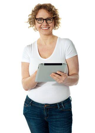 i pad: Senior woman holding tablet, smiling  Isolated on white background