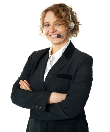 Customer service operator smiling with crossed arms Stock Photo - 13324943
