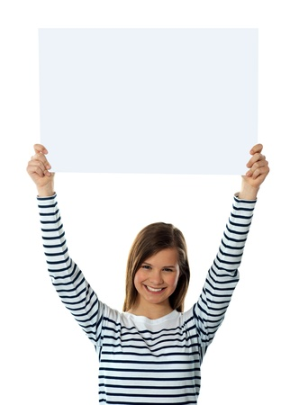 Cute girl lifting blank placard high, isolated agianst white background Stock Photo - 13324606