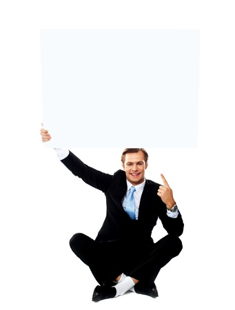 business products: Business professional pointing up towards blank placard  Studio shot