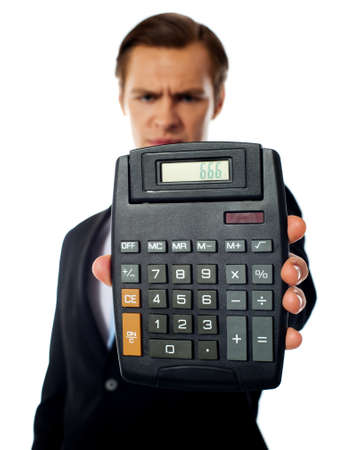 Businessman holding a calculator on a white background photo