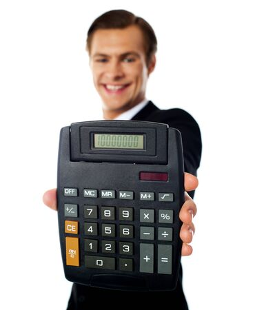 Smiling modern businessman showing calculator isolated over white photo