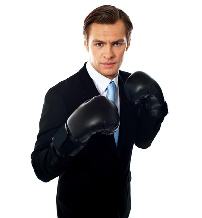 Handsome businessman posing in boxing gloves over white background photo