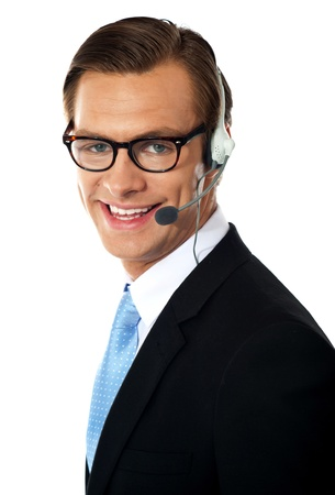 Smiling telemarketing male executive, closeup shot  Smiling photo