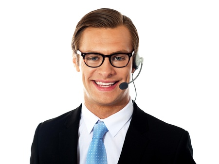 Closeup shot of male customer support member wearing headsets, smiling photo