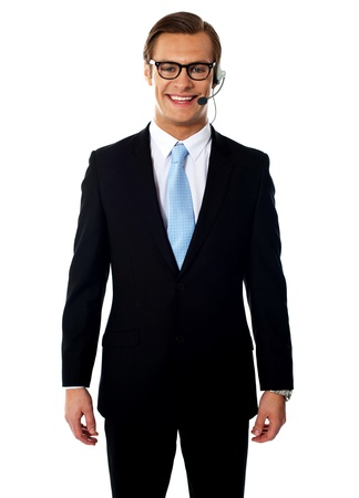 Smiling m ale telemarketer posing in headsets isolated against white background photo