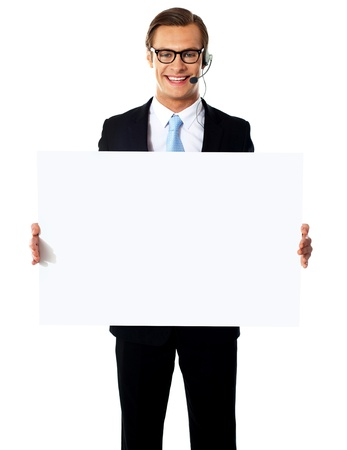 Smiling customer service male operator holding blank white billboard Stock Photo - 13373341