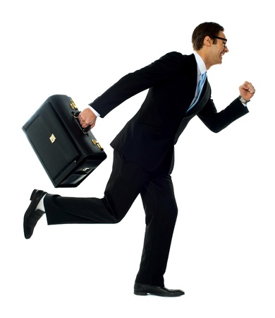 running businessman: Professional man in running a posture with briefcase  Studio shot