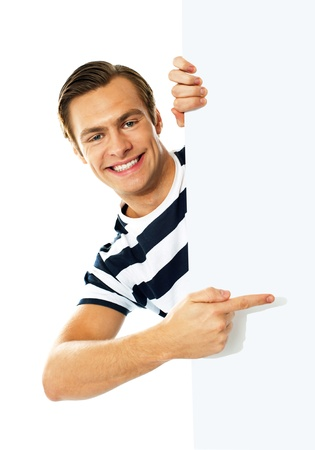 Handsome person pointing on blank signboard isolated against white background photo
