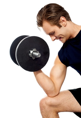 Portrait of young fit trainer working out with dumbbells isolated over white photo
