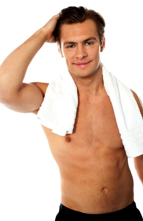Handsome young shirtless man with white towel around his neck photo