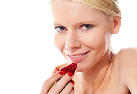 Smiling young gorgeous girl holding strawberry and looking at camera Stock Photo - 13447652