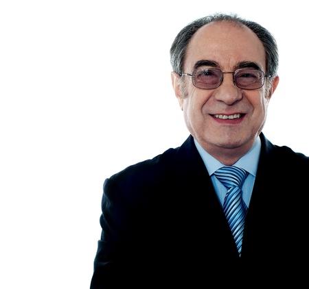 spokesperson: Smiling aged businessman wearing glasses, closeup shot