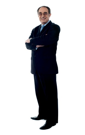 Smiling senior executive posing with folded arms dressed in black suit Stock Photo - 13511276