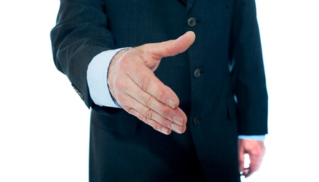 Close-up of businessman offering hand for handshake  Isolated on white background Stock Photo - 13511562