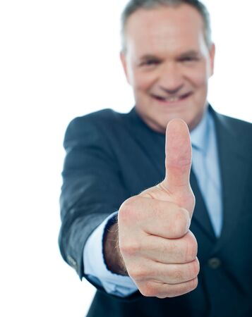 Matured businessman showing thumbs-up gesture isolated on white Stock Photo - 13511484