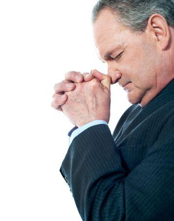 man praying: Portrait of matured businessman praying isolated on white background Stock Photo