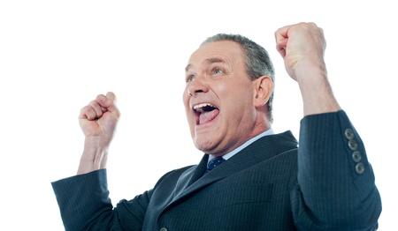 Elder businessman in a victory pose  Isolated over white Stock Photo - 13513013