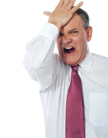 disturbed: Cropped image of a disturbed businessman with  hand on his head Stock Photo
