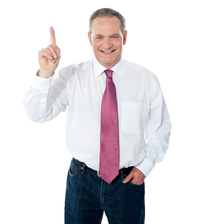 Smart businessperson pointing upwards  over a white background photo