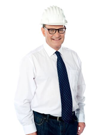 Handsome smiling aged engineer with hard hat on his head isolated on white Stock Photo - 13513001