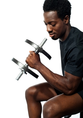 Portrait of happy fit african man working out with dumbbell Stock Photo - 13513038