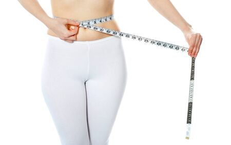 Woman measuring her abdomen with metre isolated over white background Stock Photo - 13739121