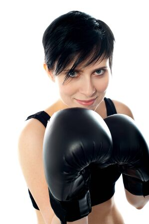 Attractive caucasian girl practicing boxing, isolated on white background photo